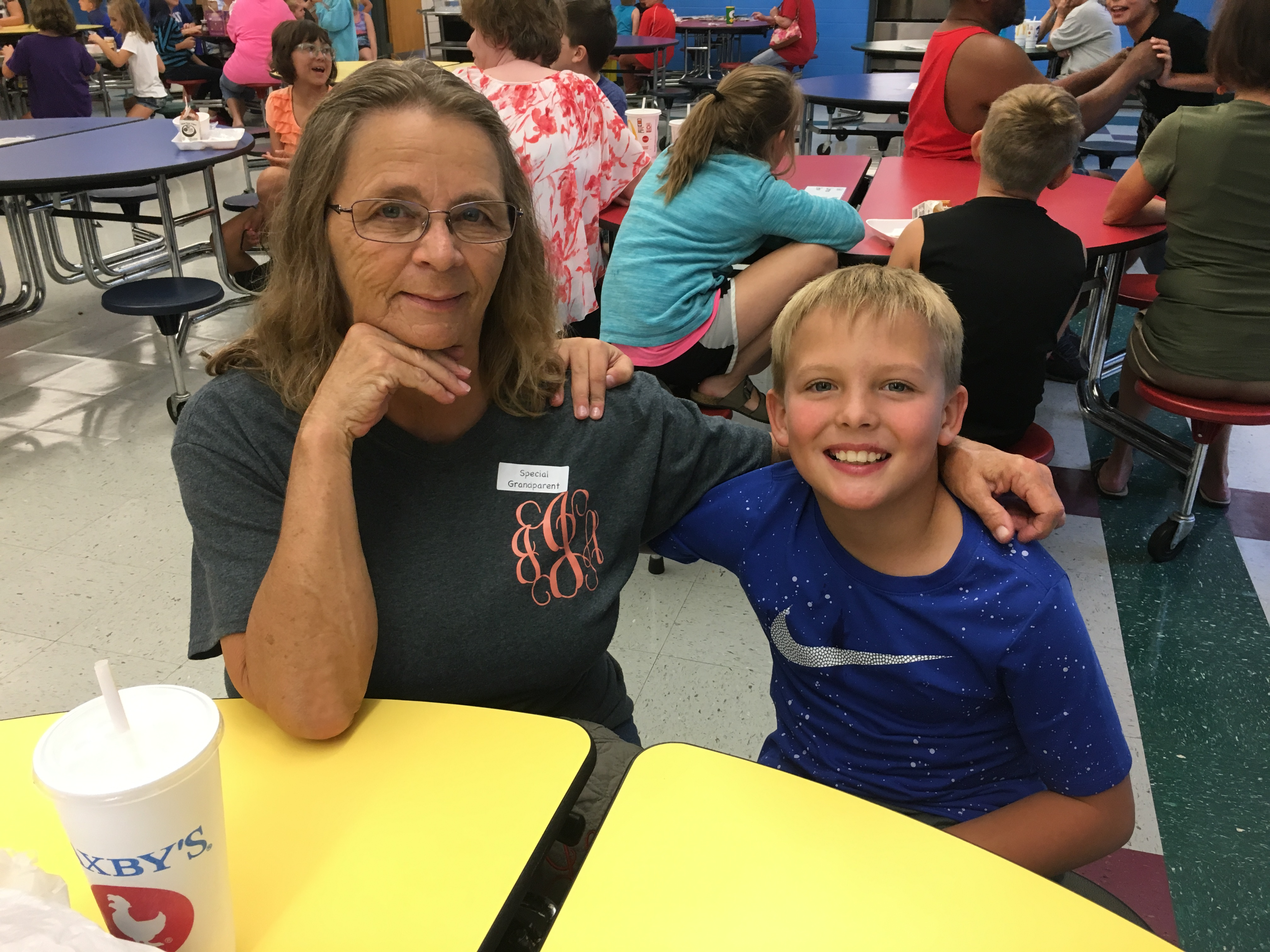 One of our 4th graders and his grandma.
